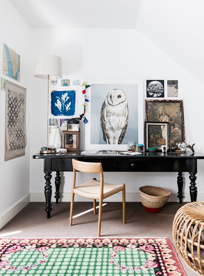 Richard's desk, a streetside find, was given a glossy black paint finish and now takes pride of place in the study. Møller chair, from Great Dane. Artworks include a striking owl photographic artwork by Leila Jeffreys and a classic Indian subject by Ravi Varma.