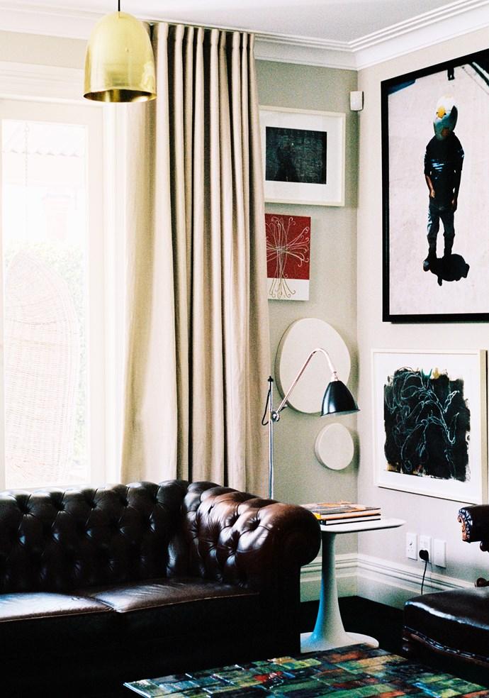 """Karen says decorating is about filling the house with """"objects and pieces I love – not lots and lots of things"""". This includes a good sprinkling of art. Among the works in the sitting room is a print by photographer Mark Smith. The red and white work is by New Zealand artist John Reynolds."""