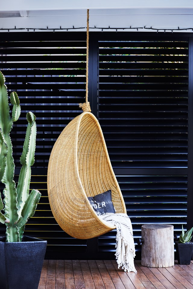 Modern sleek meets boho chic with this hanging egg chair in a [renovated Queensland worker's cottage](http://www.homestolove.com.au/tips-from-a-diy-renovation-of-a-workers-cottage-5060). *Photo: Alicia Taylor / real living*