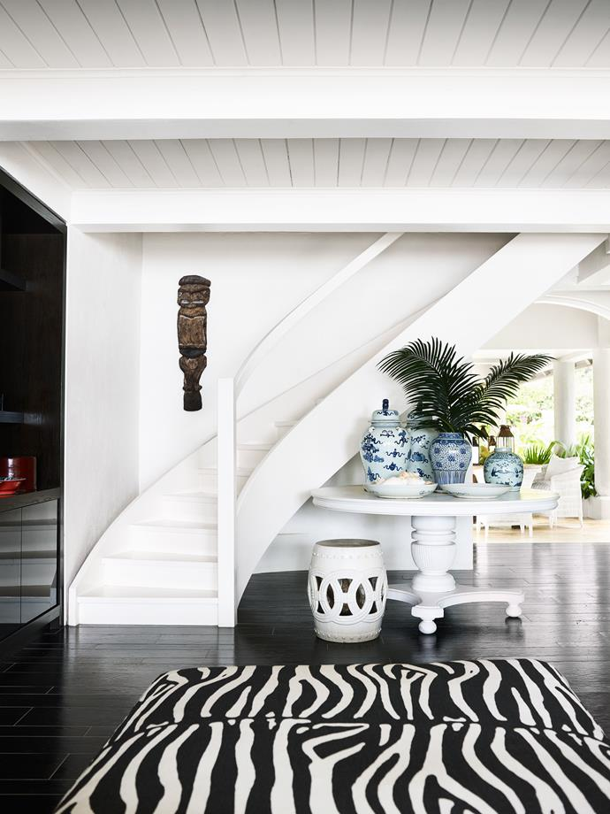 With its Vanuatan ceremonial figure, the entrance hall is testament to Elizabeth's talent for blending styles.