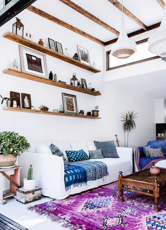 "Stepping into Amelia Mather's [global-inspired home](https://www.homestolove.com.au/a-global-inspired-home-in-the-heart-of-sydney-5087|target=""_blank""), you immediately know you're in the domain of a lady who lives and breathes the kind of relaxed, boho style that can only belong to a true globetrotter. African indigo textiles, bright Boujaad vintage rugs and handcrafted timber furniture collected on travels, inject character and soul. *Photo:* Maree Homer"