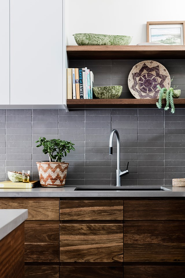 **Down to earth** This soulful space features a mix of natural finishes like stone, timber and concrete to create a durable kitchen with a bohemian feel. *Photo:* Maree Homer