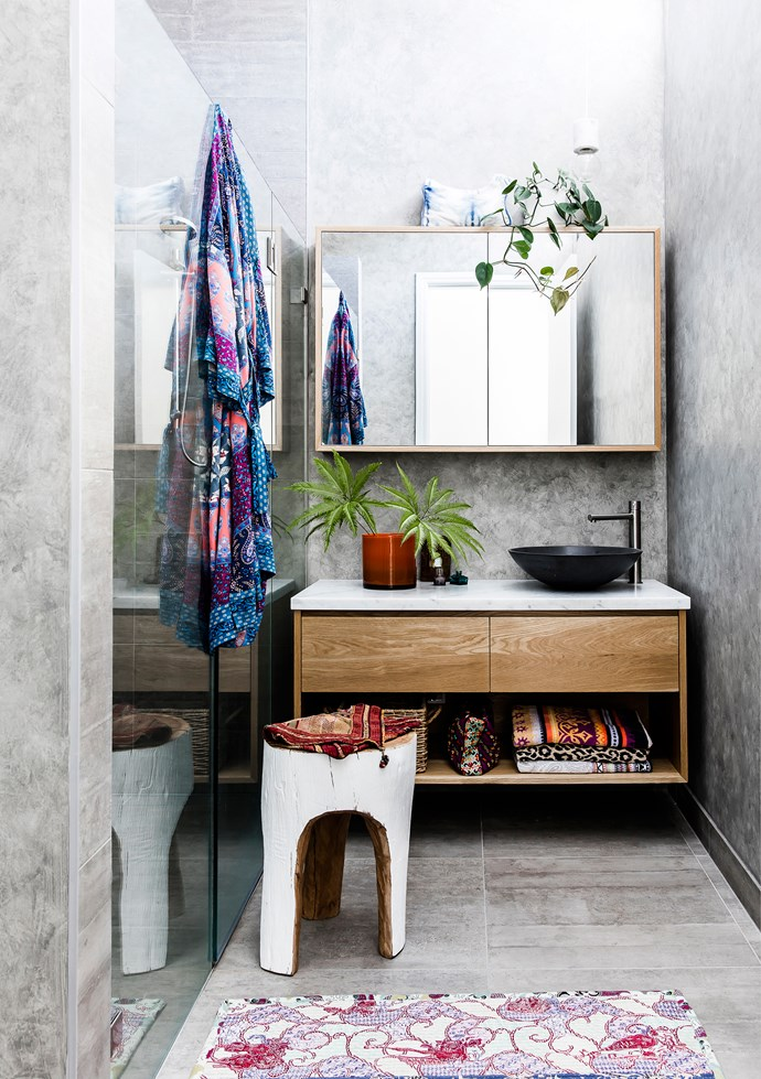 Amelia used a French wash from Porter's Paints to complement the Di Lorenzo tiles in the bathroom. She then layered colour and texture over the greys with a stool from Koskela and vase from Pleine Nature. The towels, bathmat and washbags are all Tigerlily.