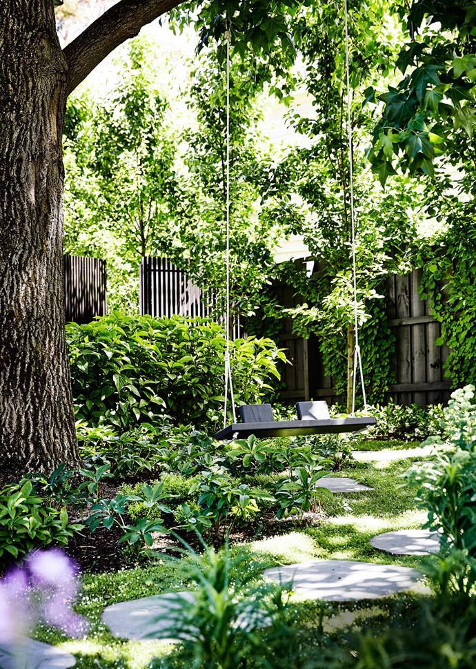 A homemade swing is Lynn's favourite place to sit and water her plants while marvelling at the beauty around her.