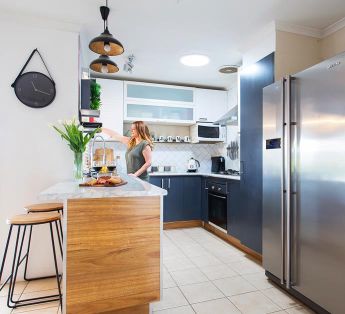 """The original """"off the plan"""" kitchen has been completely overhauled by Jessica and Osvaldo. Lightening up this much used space was a priority, so a skylight was installed to bring in natural light."""