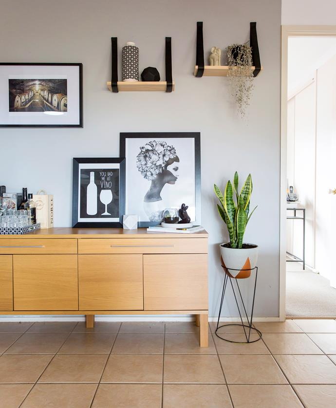 Jess made the timber and leather shelves above their eBay Ikea sideboard for $20.