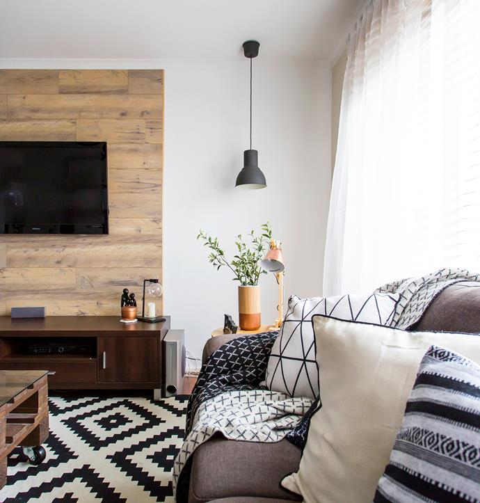 Warmth is added to the monochrome living room with timber finishes and touches of copper.