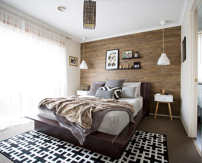 Timber-look vinyl planks attached with liquid nails create a stunning feature wall.