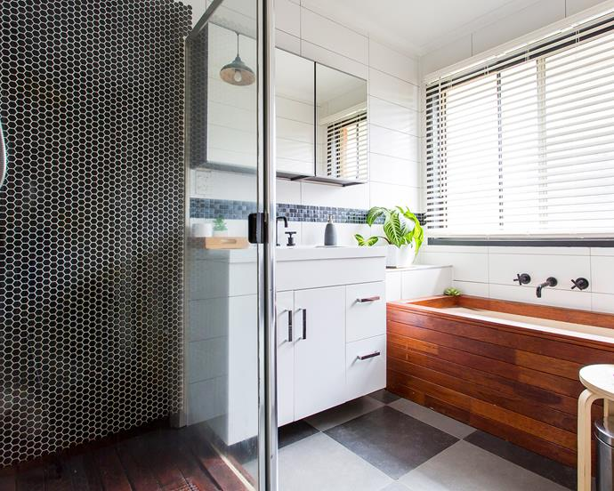 Mirror cabinets maximise storage and reflect light, while black mosaic tiles add glamour.