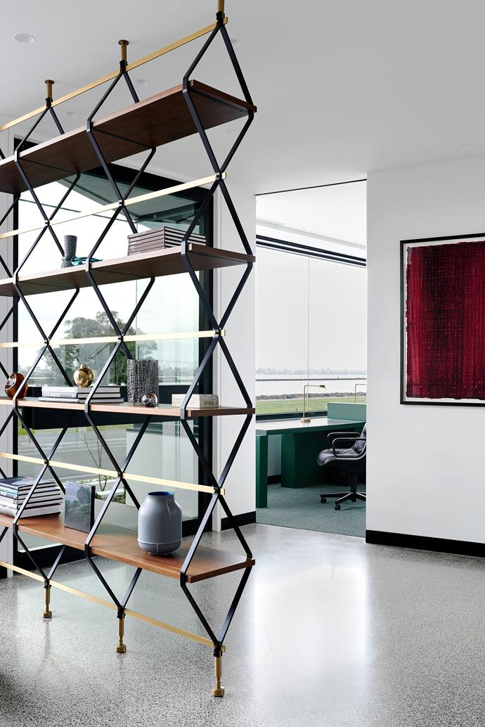 A 'Romboidale' bookshelf by Pietro Russo from Criteria delineates the entry space and holds a collection of pieces from Design Stuff, Safari Living and Hub. Wire sculpture by Neil Taylor from Niagara Galleries. (HO10-8) artwork by Hu Qinwu from Niagara Galleries. A view through to the study area where a KnollStudio 'Pollock' chair from De De Ce is perfectly positioned to take in the waterside panorama.