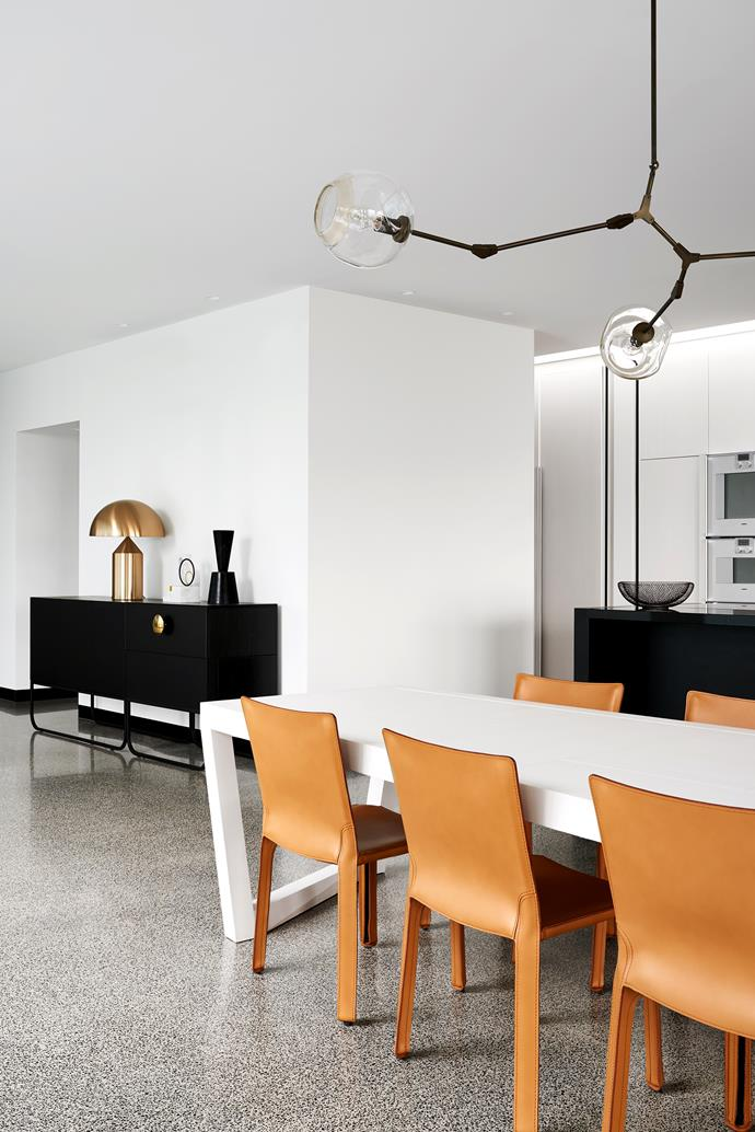 Cassina 'Cab' chairs surround a Christophe Delcourt 'Ibu' dining table from Ondene.
