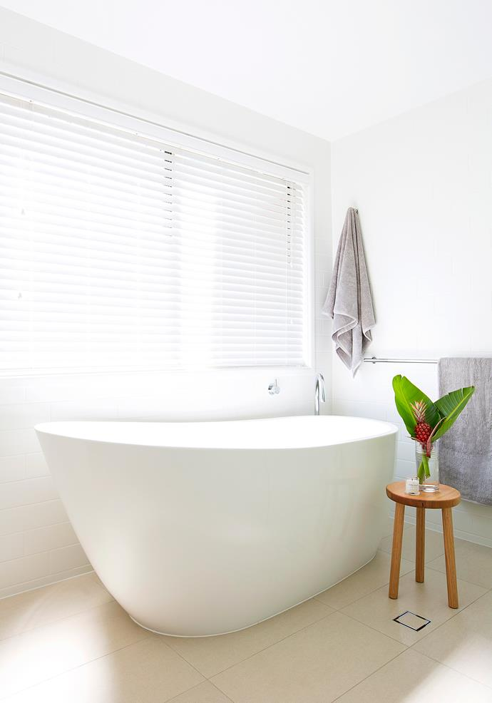 The renovation combined the main bathroom and toilet into one luxurious space.