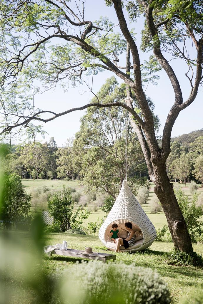 "Owner Elise Pioch and her daughter Loulou relax in what the family calls its 'nest'. The hanging chair, a wedding present, is imbued with ""beautiful memories"", says Elise."