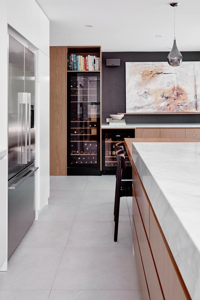 The design teams favourite feature is the bar/wine storage area and bench-top alongside the pivoting door that at first glance looks like additional wine storage but is in fact access to the laundry behind.
