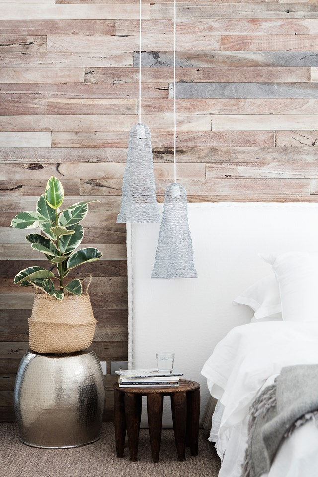"The boho look doesn't always involve clashing colours and patterns. In this neutral [bohemian bedroom](https://www.homestolove.com.au/10-bohemian-bedrooms-perfect-for-free-spirits-5766|target=""_blank""), wood panelling adds tone and texture against a clean white back-drop. *Photo:* Bo Wong / *bauersyndication.com.au*"