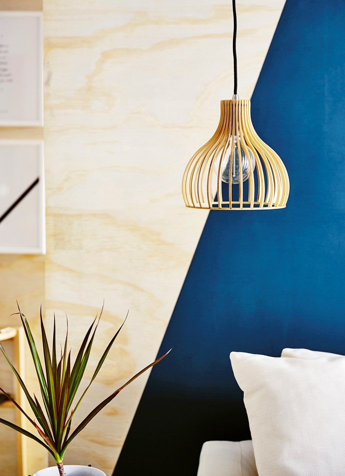 Add contrasting soft curves to the space with a pendant.
