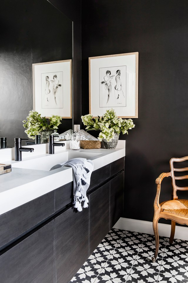 "The master ensuite of this [colourfully renovated brick home](https://www.homestolove.com.au/a-brick-home-brought-to-life-with-a-colourful-interior-5148|target=""_blank"") greatly contrasts the main bathroom on the first floor with its sophisticated black and white palette. Touches of timber keep the space feeling warm and homely. *Photo: Maree Homer / Story: Australian House & Garden*"