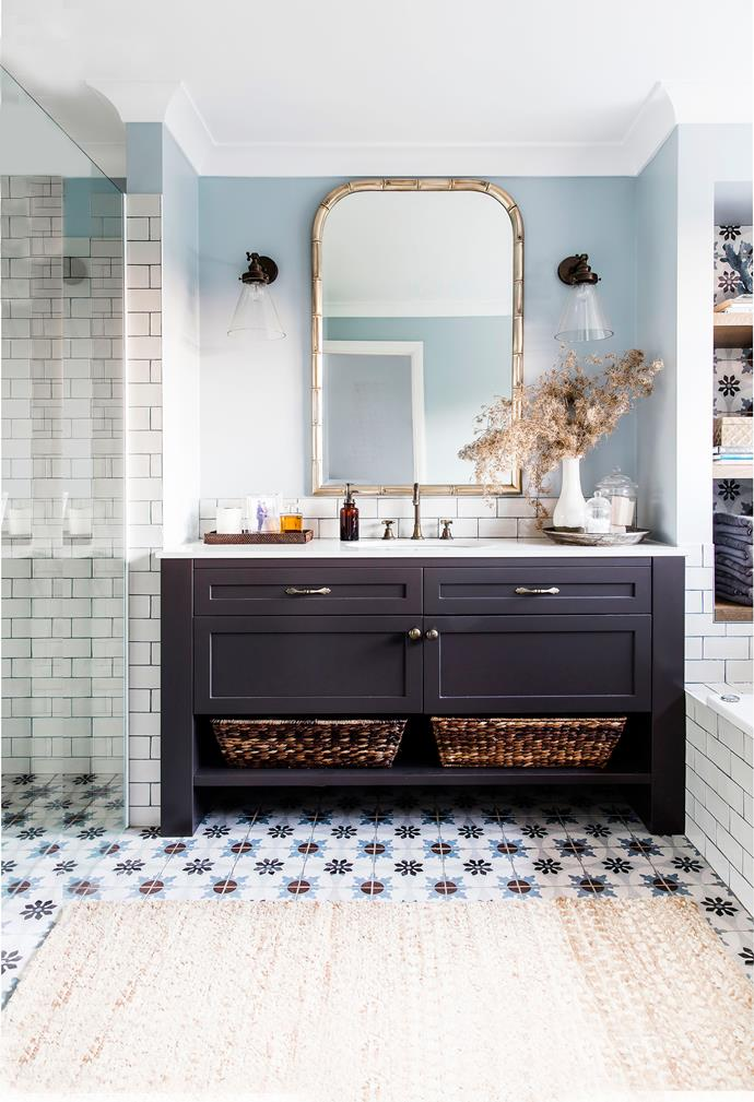 In the main bathroom coloured grout between the subway tiles picks out tones in the decorative floor tiles from Beaumont Tiles. Joinery by Festoni, painted in Dulux Mossman Gorge. Tapware, from The English Tapware Company. Wall lights, from Emac & Lawton. Mirror, from Xavier Furniture.