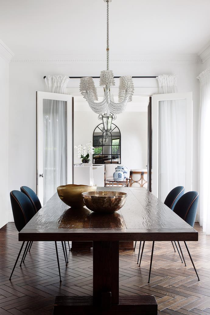 """In the informal dining area, 'Gubi' chairs from Luke Furniture. Tom Dixon 'Bash' bowl (left) from Safari Living. Vintage Barovier & Toso 'Rostrato' chandelier from [Nicholas & Alistair](http://www.homestolove.com.au/interview-with-gallery-owners-nicholas-and-alistair-3734