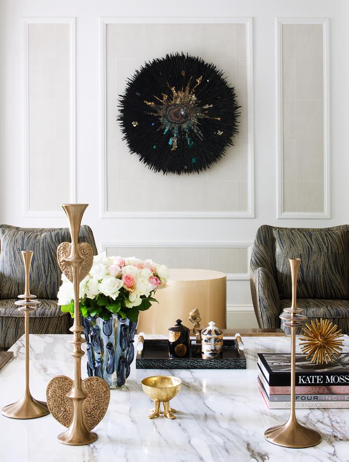 In the formal living room, Guglielmo Veronesi 1950s Italian armchairs reupholstered in Groundworks 'Currents' fabric by Kelly Wearstler from Elliott Clarke. Vintage candlesticks from Napoleon Perdis Life.Style. 'Big Bang' wall sculpture by Béatrice Serre from Galerie Michèle Hayem, Paris.
