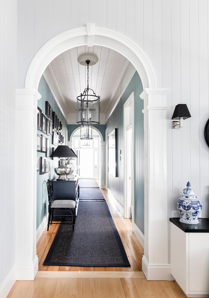 "The original hallway is the transition point between the old and new parts of the house. The pine floors were sanded back and walls painted in Dulux Wave Jumper. ""It's a wonderful, neutral blue that goes with anything and sets the tone for the colour scheme in the rest of the house,"" says Rowena."