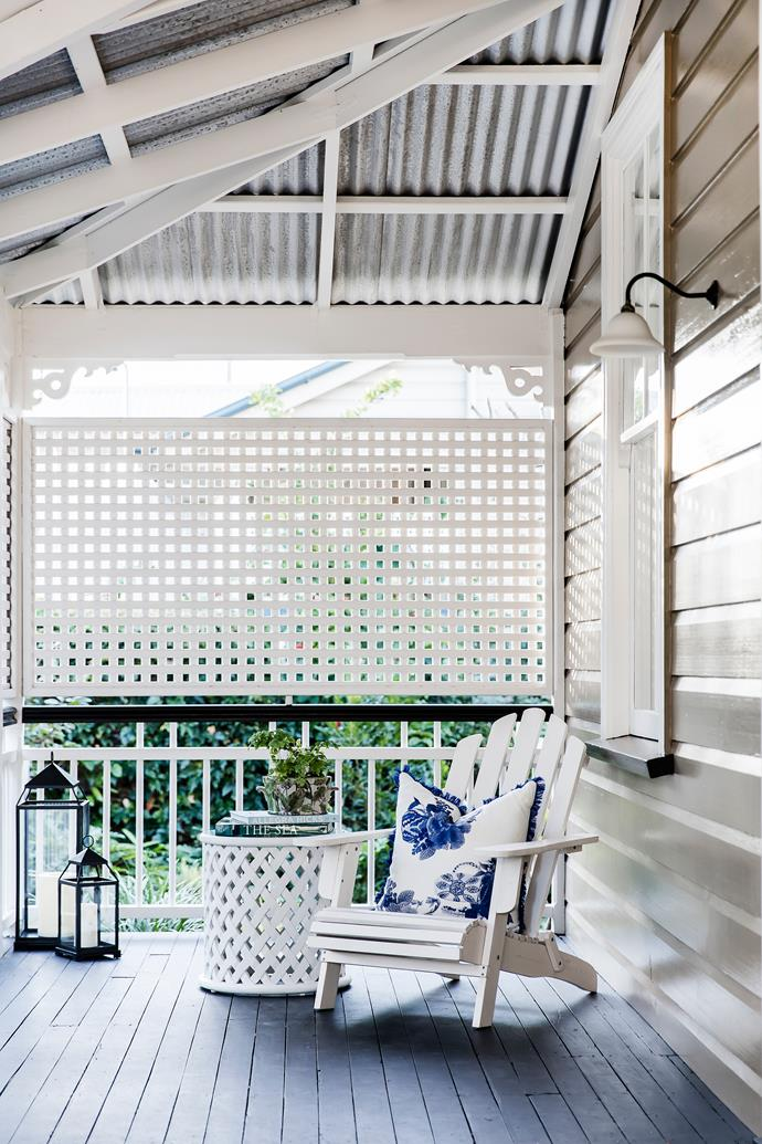 Enclosing the verandah is a nod to the home's history, and creates a private and shady spot to read while enjoying the cooling breezes from the nearby Brisbane River.