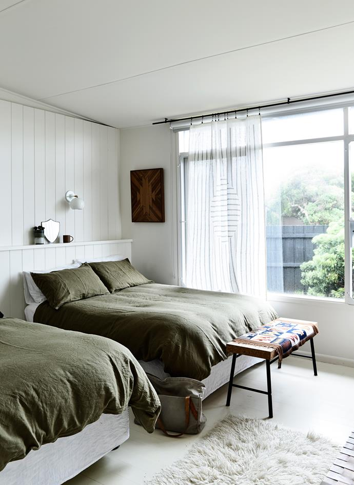 "A [guest bedroom](http://www.homestolove.com.au/7-shortcuts-to-create-the-perfect-guest-bedroom-1729|target=""_blank"") features two double beds. The bench is from the [""Sinnerlig"" Ikea range by Ilse Crawford](http://www.ikea.com/au/en/catalog/categories/collections/31586/