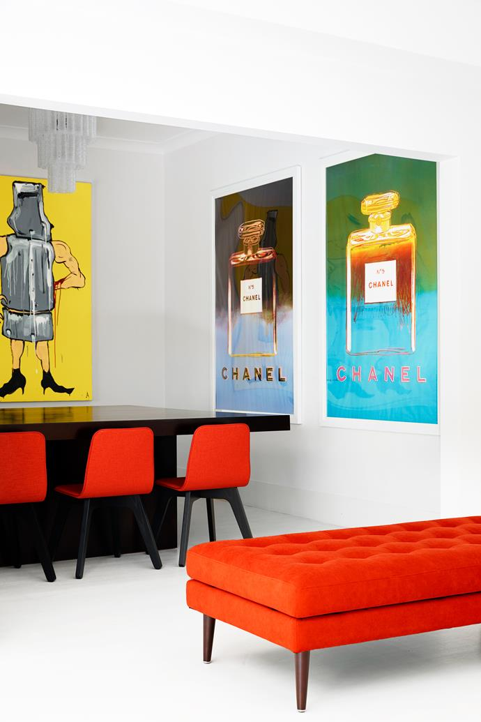 Adam Cullen Ned Kelly (2007) artwork and Andy Warhol limited-edition Chanel prints created for a film set hang in the dining room. Upholstered bench from King Living.