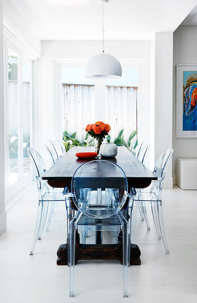 Kartell 'Louis Ghost' chairs by Philippe Starck make a statement in the dining area.