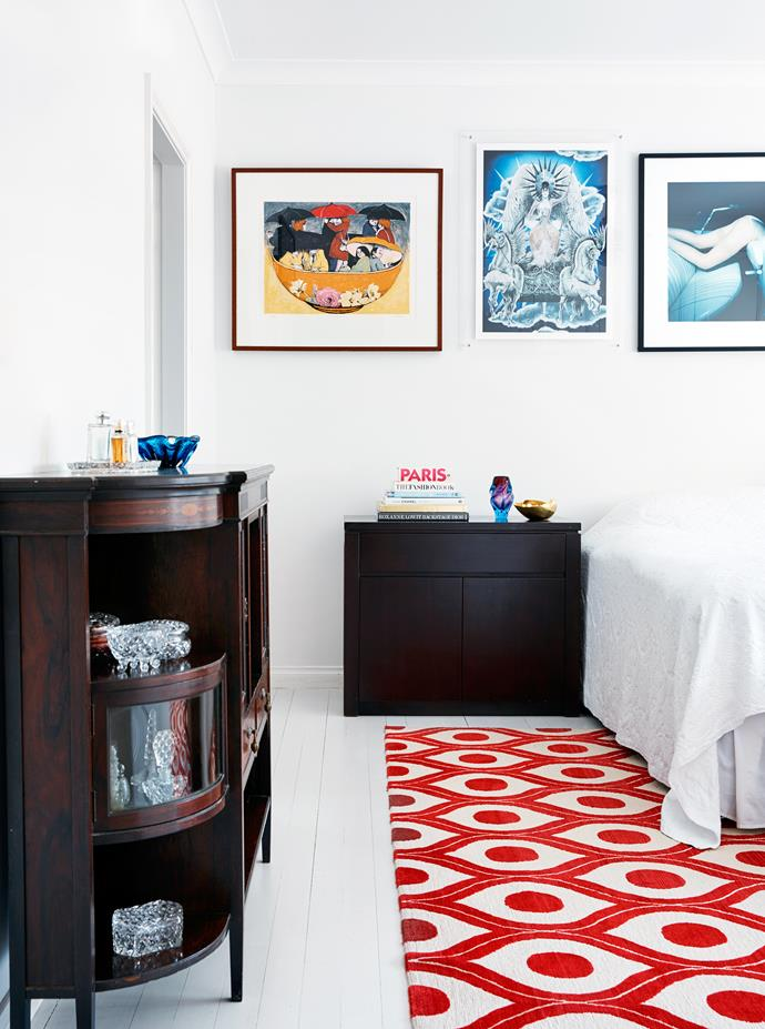 In the bedroom, a holograph print of Kate Moss above the bed was originally the invitation to an Alexander McQueen runway show, which arrived as a large-scale poster. Florence Broadhurst 'Honeycomb' rug from Cadrys.