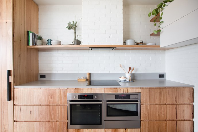 """I wanted to house the rangehood but I didn't want to interrupt the flow of the brick wall, "" says Kate. ""So we enclosed it in brickwork – it's one of my favourite features."""
