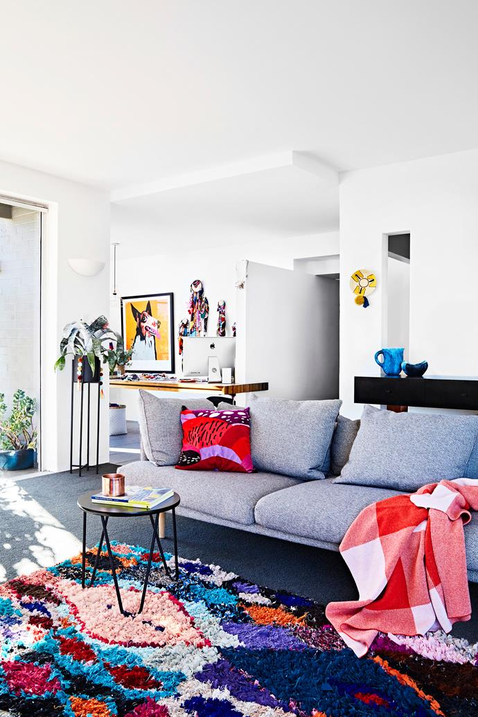"""I love this room as it's surrounded by floor-to-ceiling windows,"" Letitia says of the living room. ""We see right out onto the street through the trees and onto the courtyard above the pool area that has the trunk to our very beautiful white gum."" Nook sofa by Jardan, rug by Love Moroccoan Rugs."