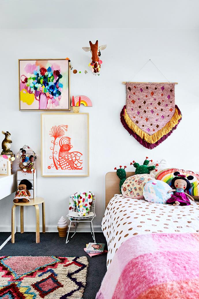 Letitia extends her fierce love of colour to Tippi's bedroom, creating a rainbow wonderland. Frankie bed from Domayne, wall hanging by Kip&Co, bedlinen from Adairs, rug from Love Moroccan Rugs, painting by Chris Minter.