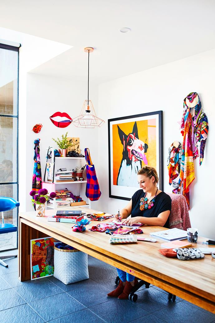"""I love that I'm able to work here and create while watching Tippi play, sometimes she even joins me at my desk."" Letitia says. Custom desk adjoined to wall, lip mirror by Bride & Wolfe, basket by Country Road, print by Adam Cullen and assortment of silk scarves designed by Letitia Green."