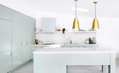 Pastel green kitchen by Three Birds Renovations