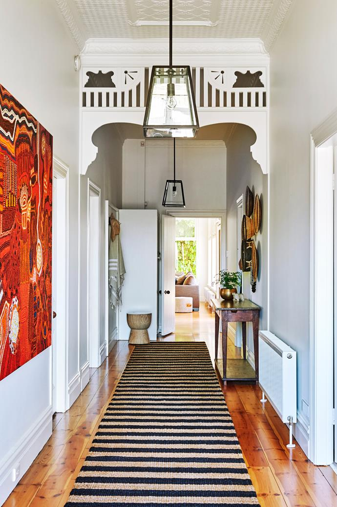 """Heavy light fixtures were swapped out for transparent pendants in the hallway. Smart buy: Southhampton 1 pendant lights, $299 each, [Beacon Lighting](https://www.beaconlighting.com.au/