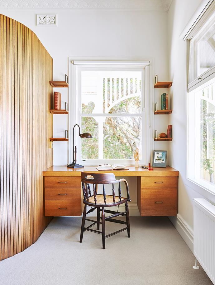 A timber nib wall installed as part of a renovation in the 1970s carves space out of the generous main bedroom for an ensuite.