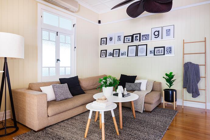 """Melissa and Brett made the two shelves in the living room that hold framed artwork and photographs. """"We couldn't find any that were long enough, so we built them,"""" says Melissa."""