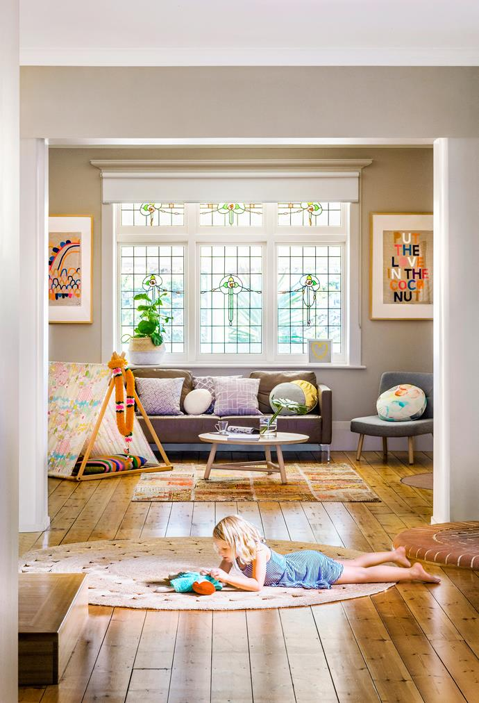 A large skylight off the dining room draws plenty of light into the core of the house, where Frankie likes to play. Dandelion rug, from Armadillo&Co. Tent, from Such Great Heights. Coffee table, from Globe West. Artworks all by Rachel Castle.