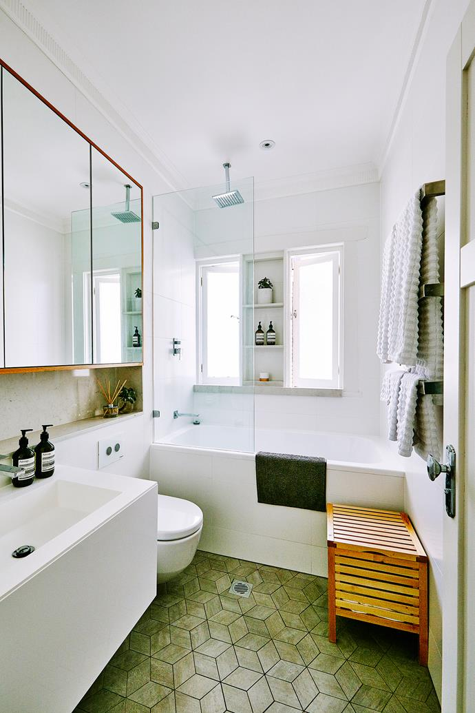 """Recessing the cabinetry and building in a niche beneath it reduced the need for a large vanity. """"The overall effect is that the bathroom feels larger than it actually is,"""" says Meg."""
