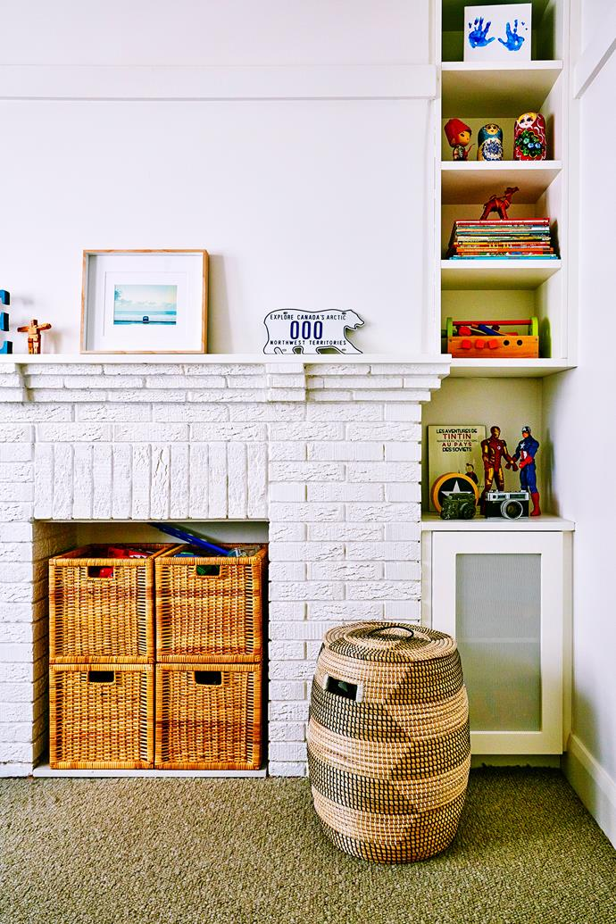 The restored fireplace has become the perfect storage nook for Ethan's toys.
