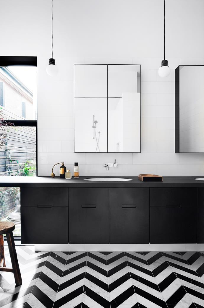 Mirrors and lights create an expansive ensuite. &Tradition 'Mass Light NA5' pendant.