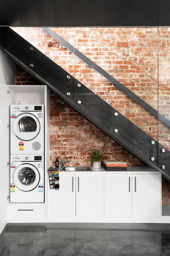"""A laundry can be customised to fit the awkward space [under the stairs](http://www.homestolove.com.au/how-to-style-the-awkward-space-under-the-stairs-3670