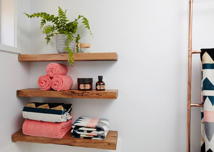 Display towels, toiletries and some indoor greenery to create a hotel-style bathroom at home.