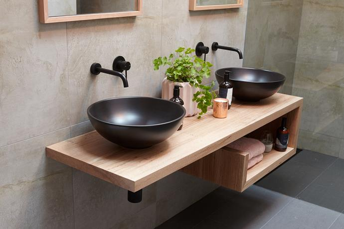 Bold matte black basins and tapware provides a welcomed contrast against the soft timber vanity.