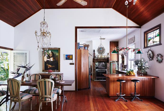 The kitchen/dining area is part of a generous open-plan space at the rear of the house. The Mona Lisa print, a prop from a 1980s Smith's Crisps ad, gazes at visitors. All other artworks are market finds.