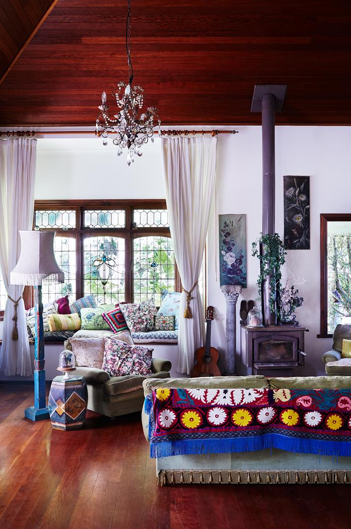 """The living area, also part of the open-plan space, is the heart of the home. """"The wood fire is a beacon in winter,"""" says Victoria."""