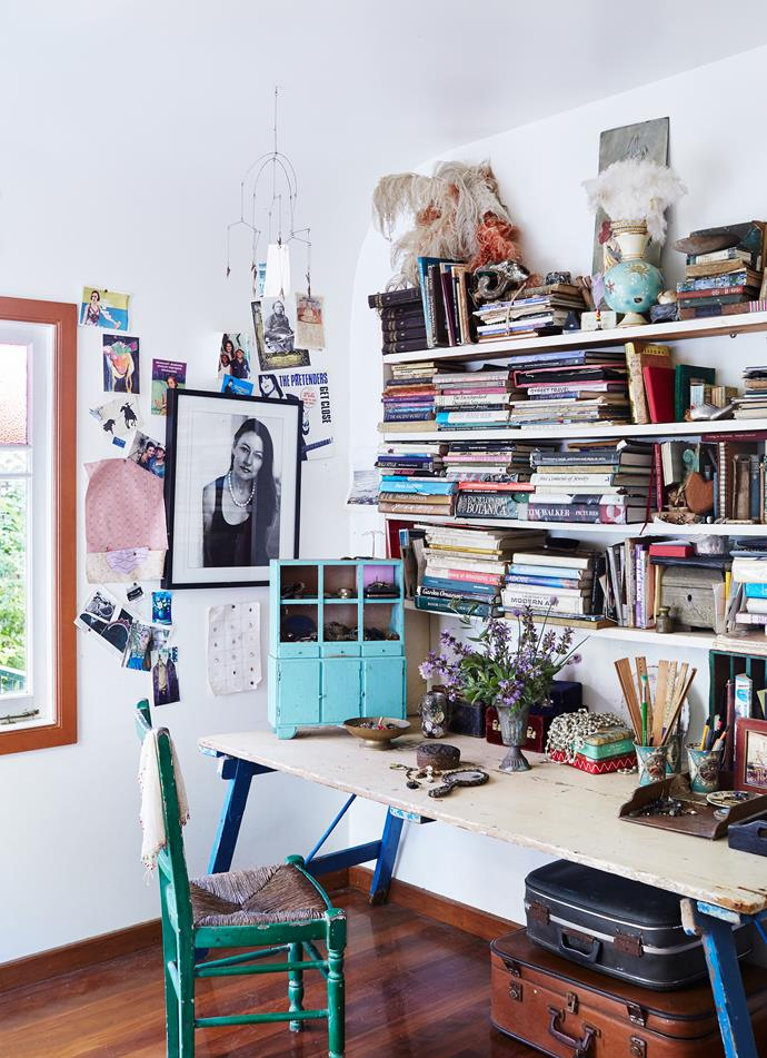 """The study is a treasure trove of reference books, memorabilia, sketches, drawings and found objects. The vase is filled with organic sage, chive flowers and olive foliage from [Brær](http://www.braerstudio.com/