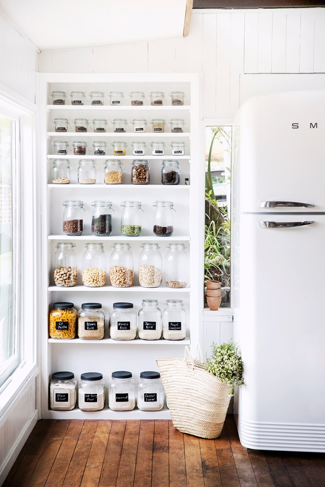 "This pantry is so organised it doesn't need a door to hide its contents. Neatly labelled glass jars arranged by height, make for a [Pinterest-worthy pantry](https://www.homestolove.com.au/perfectly-organised-pantries-6115|target=""_blank"")! *Photo:* Chris Warnes"