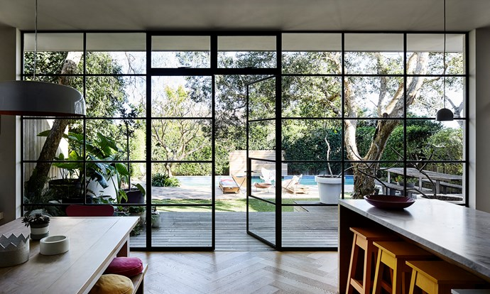 """The wall of black-steel-framed windows and doors is something Rachel was very particular about. """"The doors were custom-made in Melbourne, brought up on a truck and installed over a few days. Two things I refused to compromise on were the windows and floors, and these are the two things I'm happiest with,"""" Rachel says."""
